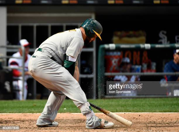 Oakland Athletics first baseman Yonder Alonso slams his bat after striking out swinging during the game between the Oakland Athletics and the Chicago...