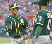 Oakland Athletics left fielder Khris Davis scores on a designated hitter Billy Butler double during the third inning against the Texas Rangers on...