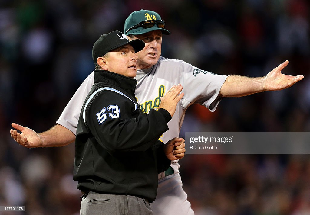 Oakland Athletics manager Bob Melvin (#6) argues a foul ball call with first base umpire Greg Gibson (#53) in the ninth inning as the Boston Red Sox played the Oakland Athletics at Fenway Park.