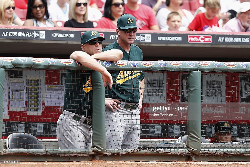 Oakland Athletics manager <a gi-track='captionPersonalityLinkClicked' href=/galleries/search?phrase=Bob+Melvin&family=editorial&specificpeople=239192 ng-click='$event.stopPropagation()'>Bob Melvin</a> looks on during a game against the Cincinnati Reds during the game at Great American Ball Park on August 7, 2013 in Cincinnati, Ohio.