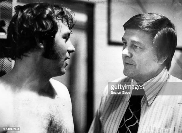 Oakland Athletics manager Dick Williams right talks to pitcher Jim 'Catfish' Hunter at Fenway Park in Boston on May 1 1972