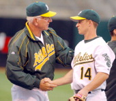 Oakland Athletics manager Ken Macha congratulates Mark Ellis after 136 victory over the Boston Red Sox at McAfee Coliseum in Oakland Calif on...