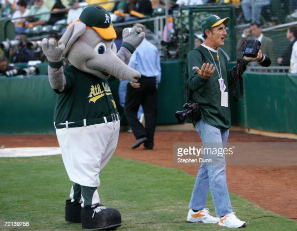 Oakland Athletics mascot mimmicks team photographer Michael Zagaris gestures before the start of Game One of the American League Championship Series...