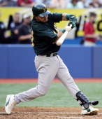 Oakland Athletics Outfielder Nick Swisher fouls off a pitch against the Toronto Blue Jays in MLB action at Rogers Centre in Toronto Canada on July 7...