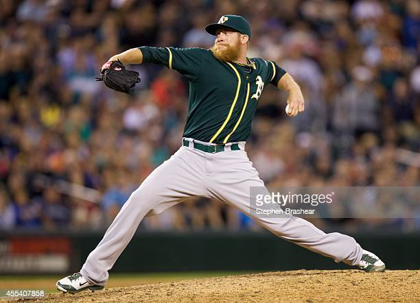 Oakland Athletics relief pitcher Sean Doolittle delivers a pitch in the tenth inning of a baseball game against the Seattle Mariners at Safeco Field...