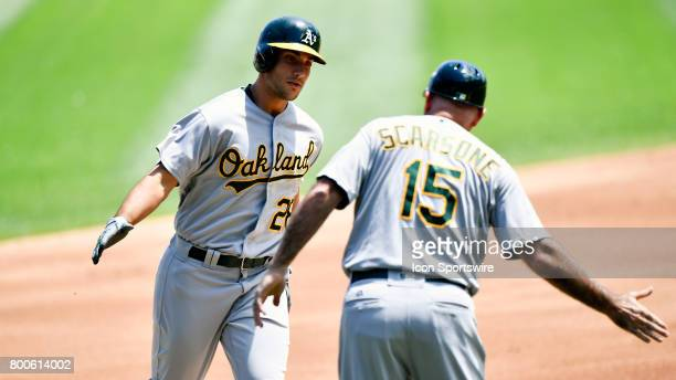 Oakland Athletics right fielder Matt Olson celebrates with Oakland Athletics acting third base coach Steve Scarsone after hitting a home run during...