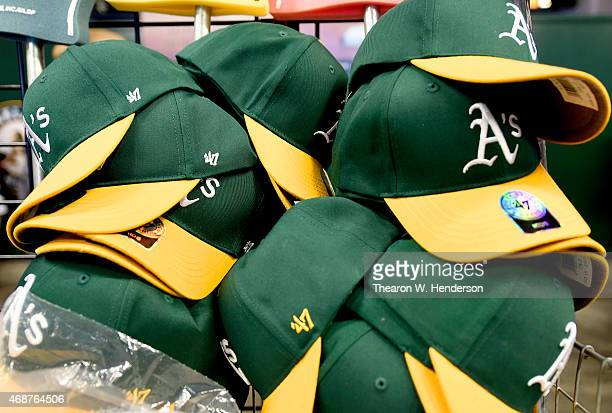 Oakland Athletics souvenir hats sit at a concession stand inside the stadium before the start of the game between the Texas Rangers and Athletics on...