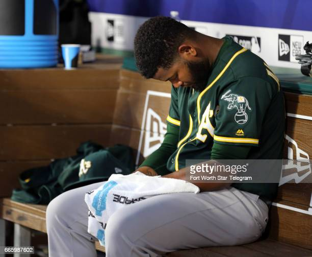 Oakland Athletics starting pitcher Raul Alcantara sits in the dugout after giving up five runs to the Texas Rangers in the second inning at Globe...