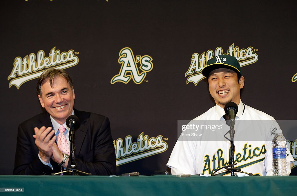 Oakland Athletics vice president and general manager <a gi-track='captionPersonalityLinkClicked' href=/galleries/search?phrase=Billy+Beane+-+Basebollchef&family=editorial&specificpeople=15746338 ng-click='$event.stopPropagation()'>Billy Beane</a> and Hiroyuki Nakajima of Japan joke with each other at a press conference where Beane introduced Nakajima to the Oakland Athletics at the O.co Coliseum on December 18, 2012 in Oakland, California. Nakajima signed a two-year contract through 2014 with a club option for 2015.
