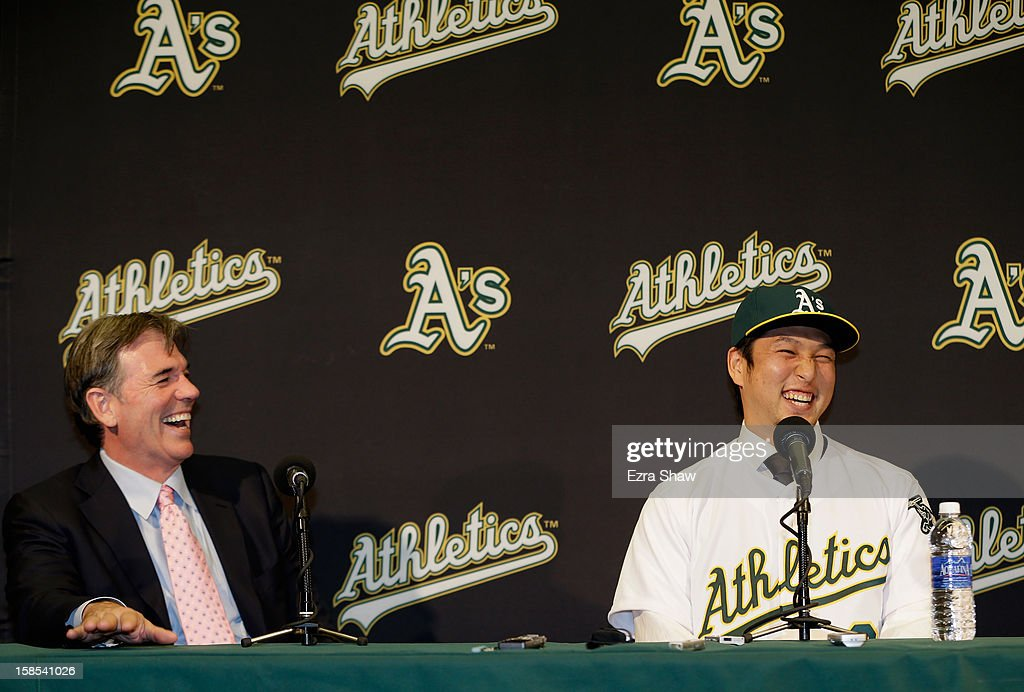 Oakland Athletics vice president and general manager <a gi-track='captionPersonalityLinkClicked' href=/galleries/search?phrase=Billy+Beane&family=editorial&specificpeople=212898 ng-click='$event.stopPropagation()'>Billy Beane</a> and Hiroyuki Nakajima of Japan joke with each other at a press conference where Beane introduced Nakajima to the Oakland Athletics at the O.co Coliseum on December 18, 2012 in Oakland, California. Nakajima signed a two-year contract through 2014 with a club option for 2015.