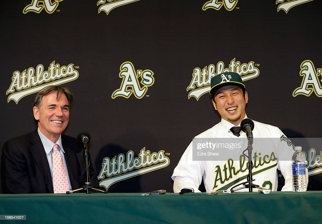 Oakland Athletics vice president and general manager <a gi-track='captionPersonalityLinkClicked' href=/galleries/search?phrase=Billy+Beane+-+Baseballdirektor&family=editorial&specificpeople=15746338 ng-click='$event.stopPropagation()'>Billy Beane</a> and Hiroyuki Nakajima of Japan joke with each other at a press conference where Beane introduced Nakajima to the Oakland Athletics at the O.co Coliseum on December 18, 2012 in Oakland, California. Nakajima signed a two-year contract through 2014 with a club option for 2015.