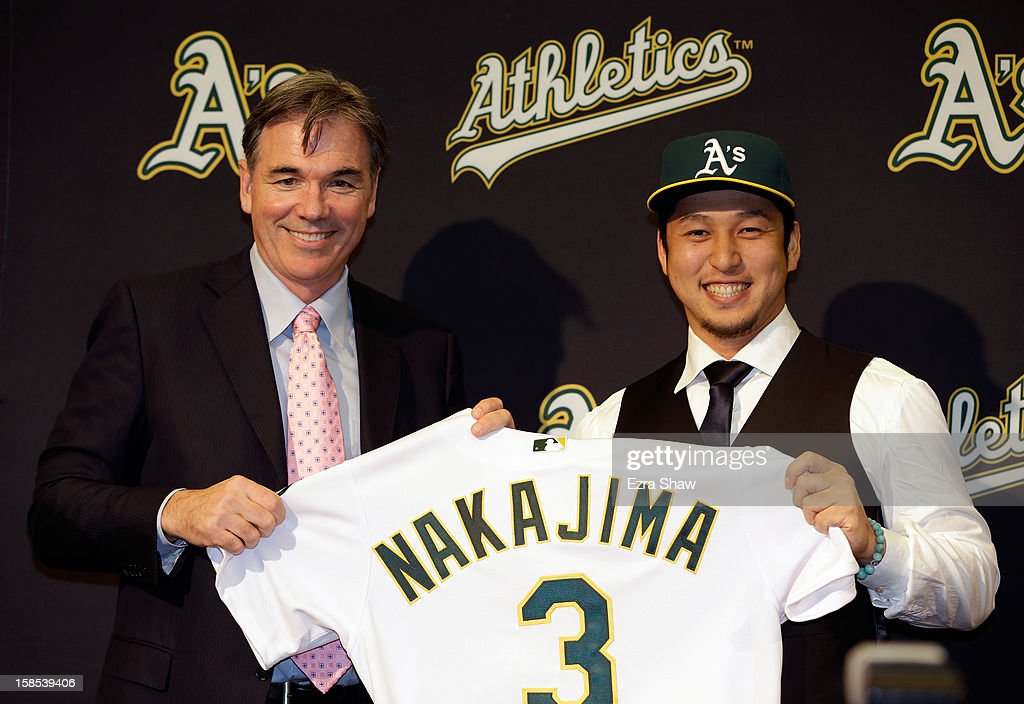 Oakland Athletics vice president and general manager <a gi-track='captionPersonalityLinkClicked' href=/galleries/search?phrase=Billy+Beane+-+Baseballdirektor&family=editorial&specificpeople=15746338 ng-click='$event.stopPropagation()'>Billy Beane</a> introduces Hiroyuki Nakajima of Japan to the Oakland Athletics at the O.co Coliseum on December 18, 2012 in Oakland, California. Nakajima signed a two-year contract through 2014 with a club option for 2015.
