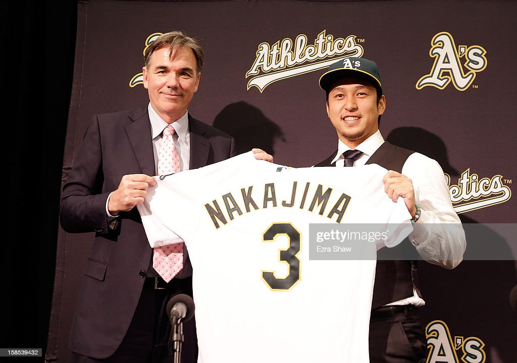 Oakland Athletics vice president and general manager Billy Beane introduces Hiroyuki Nakajima of Japan to the Oakland Athletics at the O.co Coliseum on December 18, 2012 in Oakland, California. Nakajima signed a two-year contract through 2014 with a club option for 2015.