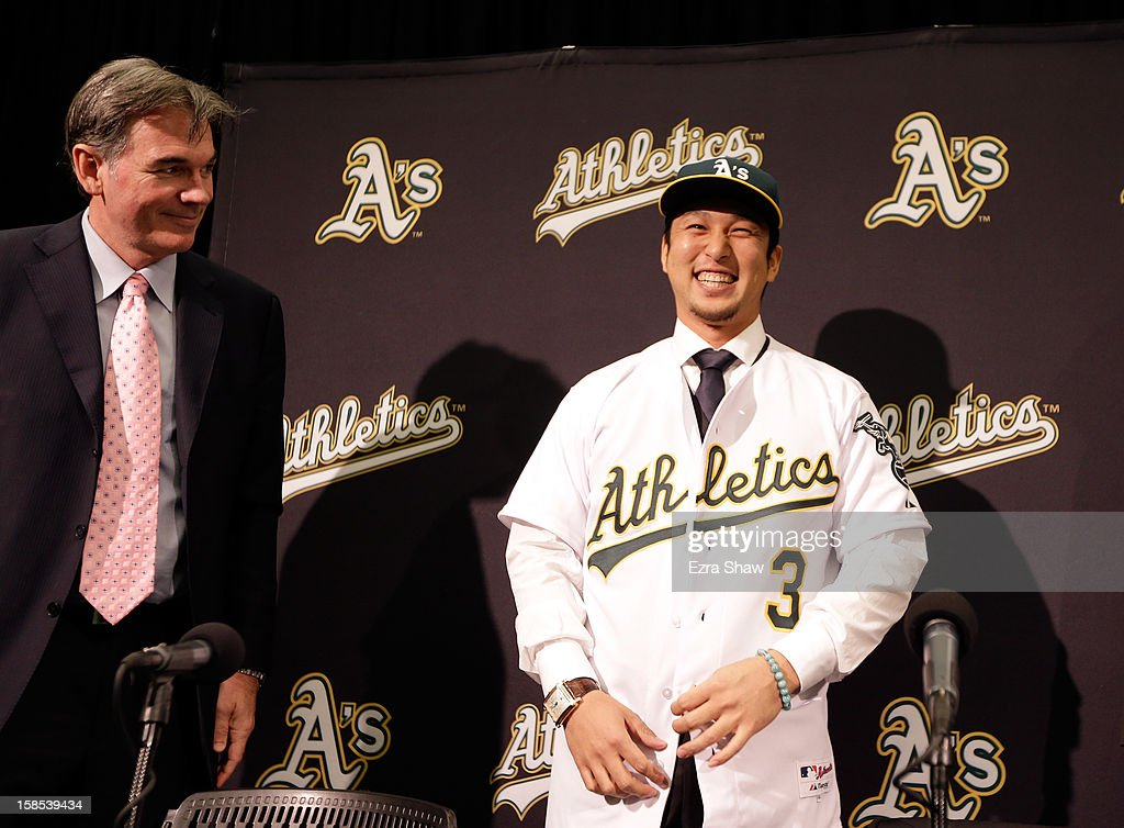 Oakland Athletics vice president and general manager <a gi-track='captionPersonalityLinkClicked' href=/galleries/search?phrase=Billy+Beane&family=editorial&specificpeople=212898 ng-click='$event.stopPropagation()'>Billy Beane</a> introduces Hiroyuki Nakajima of Japan to the Oakland Athletics at the O.co Coliseum on December 18, 2012 in Oakland, California. Nakajima signed a two-year contract through 2014 with a club option for 2015.