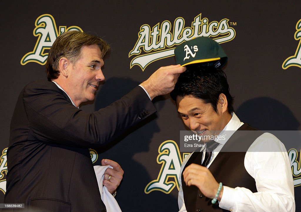 Oakland Athletics vice president and general manager <a gi-track='captionPersonalityLinkClicked' href=/galleries/search?phrase=Billy+Beane+-+Baseball+Executive&family=editorial&specificpeople=15746338 ng-click='$event.stopPropagation()'>Billy Beane</a> introduces Hiroyuki Nakajima of Japan to the Oakland Athletics at the O.co Coliseum on December 18, 2012 in Oakland, California. Nakajima signed a two-year contract through 2014 with a club option for 2015.