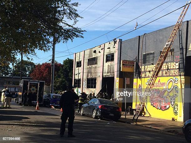 Oakland California firefighters inspect a warehouse on December 3 where a fire during a rave party killed 9 people on December 2 Nine people were...