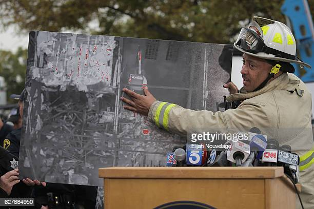 Oakland Deputy Fire Chief Darin White discusses the search efforts for victims at a media event near the site of a warehouse fire that has claimed...