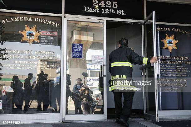 Oakland Fire and Police Chaplain Jayson Landeza enters a police substation set up as a centralized hub for friends and family of the victims of a...