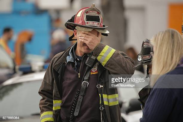 Oakland fire captain Chris Foley wipes his brow at the site of a warehouse fire that has claimed the lives of at least thirtysix people on December 5...