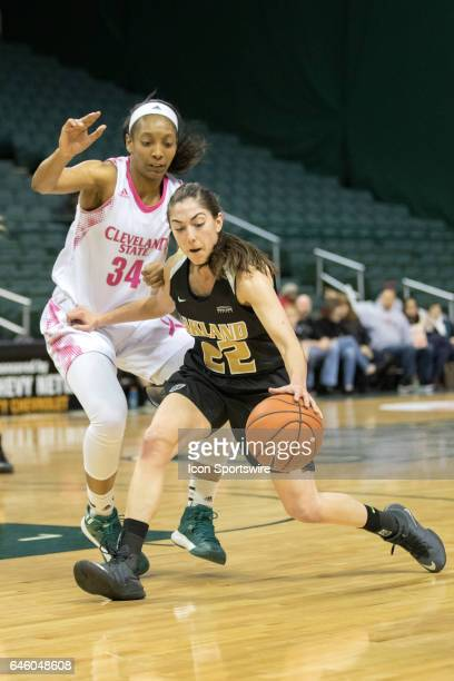 Oakland Golden Grizzlies G Taylor Gleason is defended by Cleveland State Vikings F Shadae Bosley during the second quarter of the women's college...