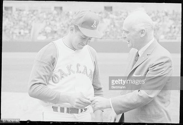 Jim Hunter got his reward for pitching the first perfect game in American League in 46 years against Minnesota from A's owner Charles O Finley before...