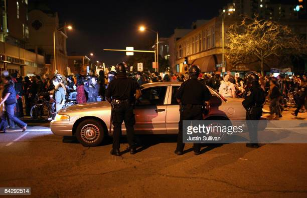 Oakland Police officers monitor a demonstration for slain 22yearold Oscar Grant III January 14 2009 in Oakland California Twelve days after the fatal...