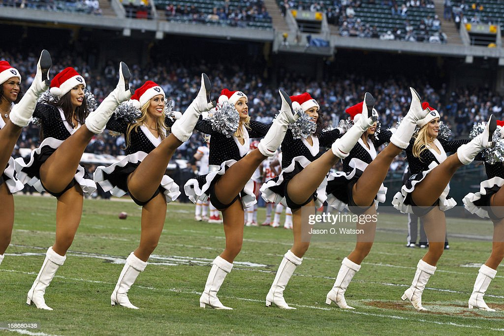 Oakland Raiders cheerleaders perform during the third quarter against the Kansas City Chiefs at O.co Coliseum on December 16, 2012 in Oakland, California. The Oakland Raiders defeated the Kansas City Chiefs 15-0. Photo by Jason O. Watson/Getty Images)