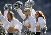 Oakland Raiders cheerleaders rally the crowd against the Denver Broncos at Oco Coliseum on November 9 2014 in Oakland California