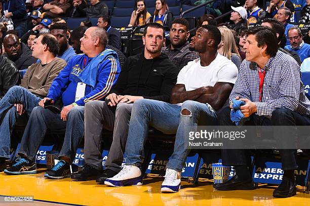 Oakland Raiders Derek Carr and Latavious Murray attends the Indiana Pacers game against the Golden State Warriors on December 5 2016 at ORACLE Arena...