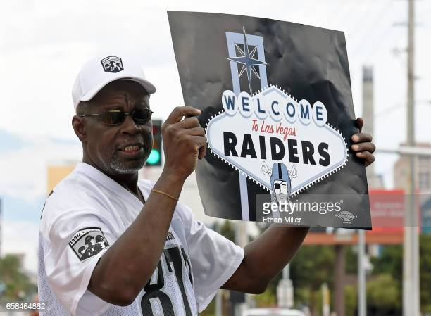 Oakland Raiders fan Davi Tole of Nevada displays a sign to passing motorists on the Las Vegas Strip near the Welcome to Fabulous Las Vegas sign after...