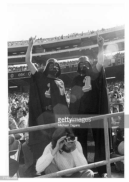 Oakland Raiders fans dressed as Darth Vader watch the game against the Denver Broncos at OaklandAlameda County Coliseum on October 16 1977 in Oakland...