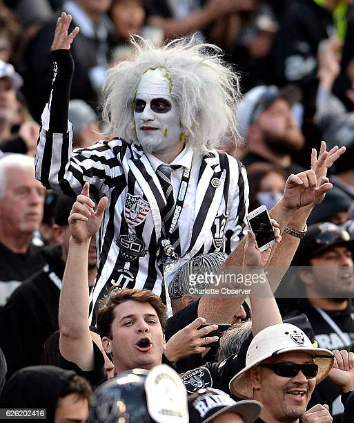 Oakland Raiders fans in The Black Hole celebrate quarterback Derek Carr's twopoint conversion pass to wide receiver Seth Roberts during fourth...