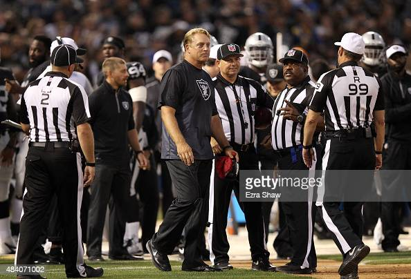 Oakland Raiders head coach Jack Del Rio talks to the officials during their game against the St Louis Rams at Oco Coliseum on August 14 2015 in...
