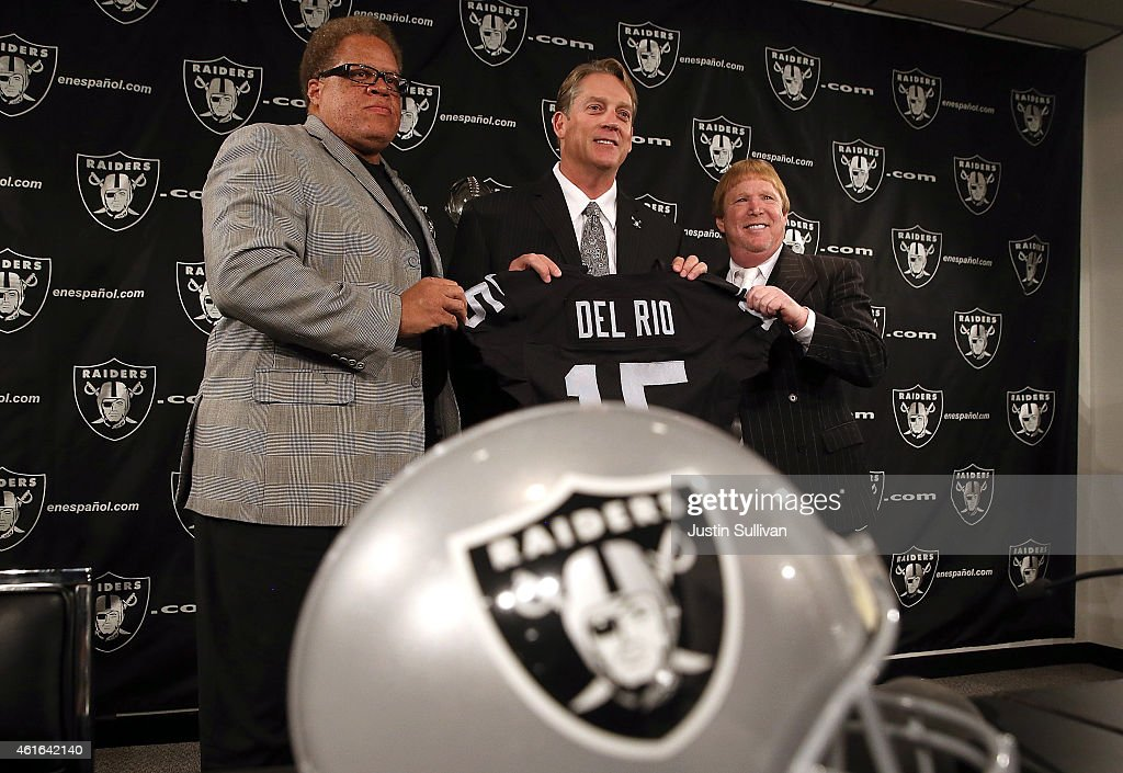 Oakland Raiders new head coach <a gi-track='captionPersonalityLinkClicked' href=/galleries/search?phrase=Jack+Del+Rio&family=editorial&specificpeople=184508 ng-click='$event.stopPropagation()'>Jack Del Rio</a> (C) holds a jersey as he poses for a photograph with Raiders general manager <a gi-track='captionPersonalityLinkClicked' href=/galleries/search?phrase=Reggie+McKenzie&family=editorial&specificpeople=604919 ng-click='$event.stopPropagation()'>Reggie McKenzie</a> (L) and Raiders owner <a gi-track='captionPersonalityLinkClicked' href=/galleries/search?phrase=Mark+Davis+-+Businessman&family=editorial&specificpeople=11308366 ng-click='$event.stopPropagation()'>Mark Davis</a> (R) during a news conference on January 16, 2015 in Alameda, California. The Oakland Raiders announced the hiring of <a gi-track='captionPersonalityLinkClicked' href=/galleries/search?phrase=Jack+Del+Rio&family=editorial&specificpeople=184508 ng-click='$event.stopPropagation()'>Jack Del Rio</a> as their new head coach.