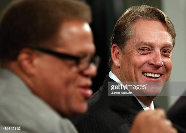 Oakland Raiders new head coach Jack Del Rio laughs with Raiders general manager Reggie McKenzie during a news conference on January 16 2015 in...