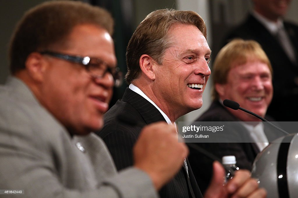 Oakland Raiders new head coach <a gi-track='captionPersonalityLinkClicked' href=/galleries/search?phrase=Jack+Del+Rio&family=editorial&specificpeople=184508 ng-click='$event.stopPropagation()'>Jack Del Rio</a> (C) laughs with Raiders general manager <a gi-track='captionPersonalityLinkClicked' href=/galleries/search?phrase=Reggie+McKenzie&family=editorial&specificpeople=604919 ng-click='$event.stopPropagation()'>Reggie McKenzie</a> (L) and Raiders owner <a gi-track='captionPersonalityLinkClicked' href=/galleries/search?phrase=Mark+Davis+-+Businessman&family=editorial&specificpeople=11308366 ng-click='$event.stopPropagation()'>Mark Davis</a> (R) during a news conference on January 16, 2015 in Alameda, California. The Oakland Raiders announced the hiring of <a gi-track='captionPersonalityLinkClicked' href=/galleries/search?phrase=Jack+Del+Rio&family=editorial&specificpeople=184508 ng-click='$event.stopPropagation()'>Jack Del Rio</a> as their new head coach.
