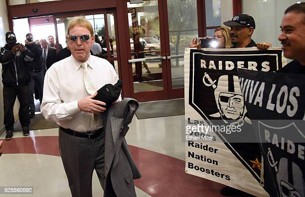 Oakland Raiders owner Mark Davis walks past fans holding Raiders signs as he arrives at a Southern Nevada Tourism Infrastructure Committee meeting at...
