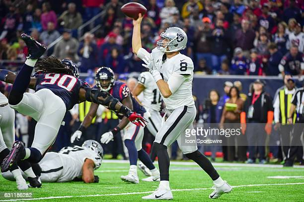 Oakland Raiders quarterback Connor Cook gets a pass off as Houston Texans Defensive End Jadeveon Clowney applies pressure during the NFL AFC Wild...
