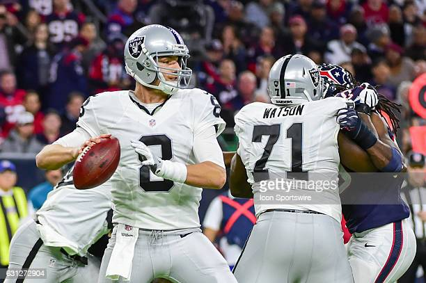 Oakland Raiders quarterback Connor Cook looks to pass downfield during the NFL AFC Wild Card game between the Oakland Raiders and Houston Texans on...