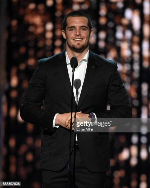 Oakland Raiders quarterback Derek Carr speaks onstage during the 52nd Academy of Country Music Awards at TMobile Arena on April 2 2017 in Las Vegas...