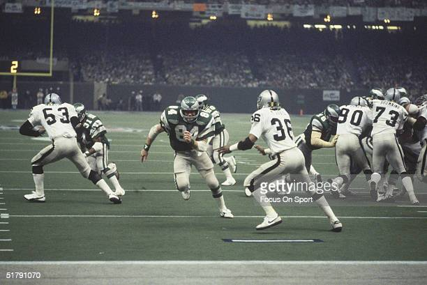 Oakland Raiders' Rod Martin Mike Davis Willie Jones and Dave Browning provide defense to stop Philadelphia Eagles' Wilbert Montgomery and his...