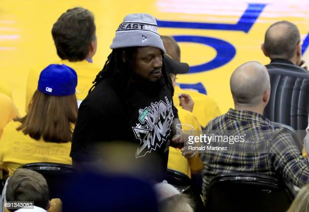 Oakland Raiders running back Marshawn Lynch attends Game 1 of the 2017 NBA Finals at ORACLE Arena on June 1 2017 in Oakland California NOTE TO USER...