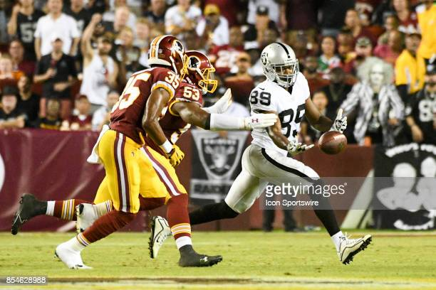 Oakland Raiders wide receiver Amari Cooper cannot hand on to pass against Washington Redskins strong safety Montae Nicholson and inside linebacker...
