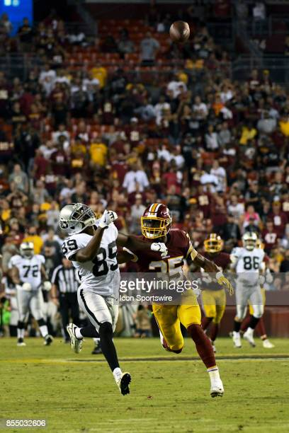 Oakland Raiders wide receiver Amari Cooper covered by Washington Redskins strong safety Montae Nicholson cannot catch a fourth quarter pass on...