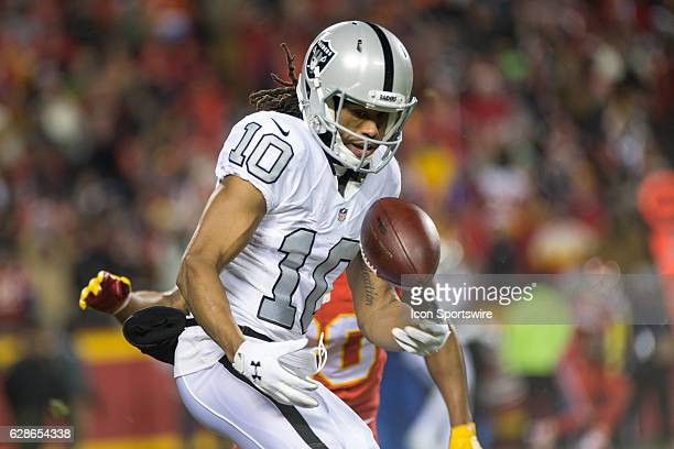 Oakland Raiders wide receiver Seth Roberts bobbles a pass during the NFL AFC West division football game between the Oakland Raiders and the Kansas...