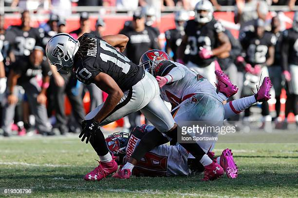 Oakland Raiders wide receiver Seth Roberts breaks a tackle from Tampa Bay Buccaneers free safety Bradley McDougald and Tampa Bay Buccaneers...