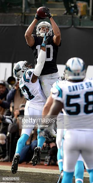 Oakland Raiders wide receiver Seth Roberts catches a touchdown pass from quarterback Derek Carr during first quarter action as Carolina Panthers...