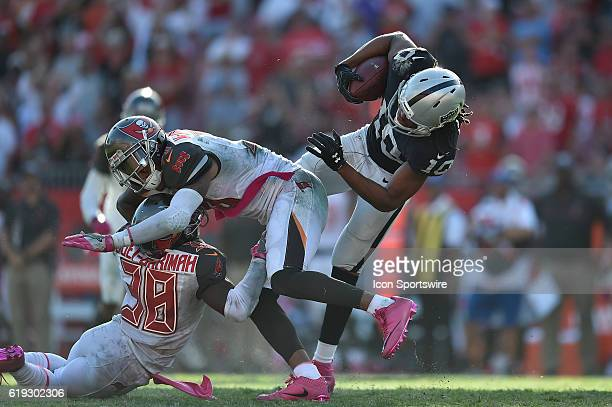 Oakland Raiders Wide Receiver Seth Roberts catches the ball and breaks a tackle to run for a 41yard touchdown in overtime during an NFL football game...