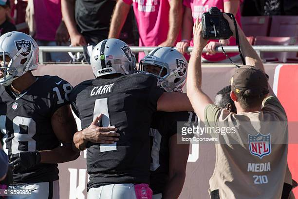Oakland Raiders Wide Receiver Seth Roberts celebrates his 41yard gamewinning touchdown catch and run with his quarterback Derek Carr during an NFL...