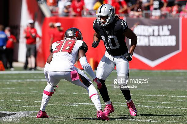 Oakland Raiders wide receiver Seth Roberts is covered by Tampa Bay Buccaneers cornerback Jude AdjeiBarimah during the NFL game between the Oakland...